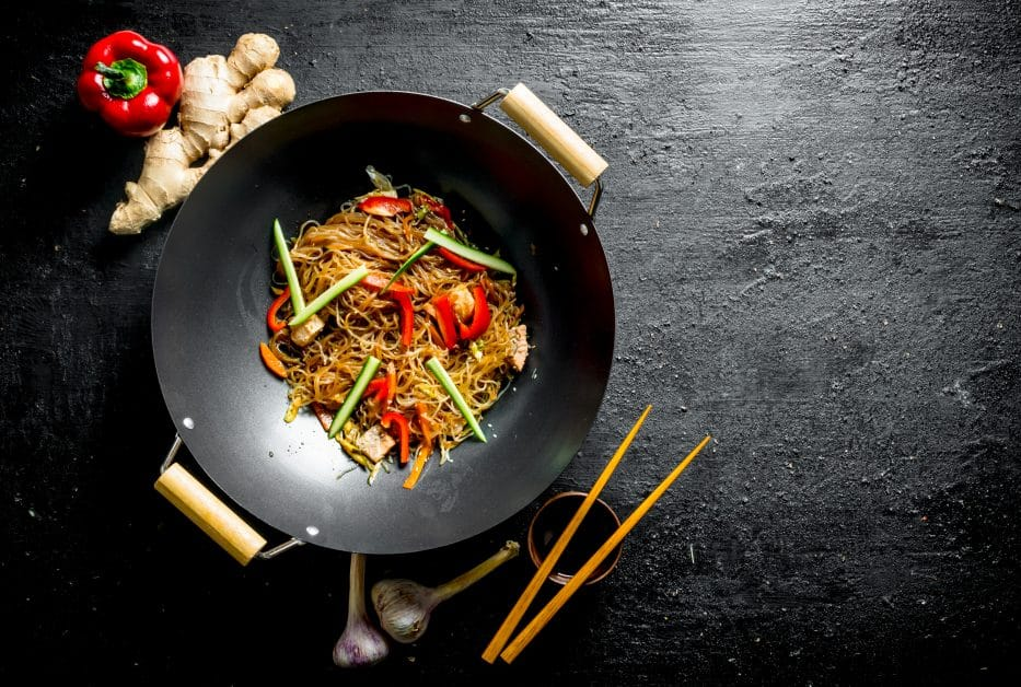 the carbon steel wok with a stir fry in