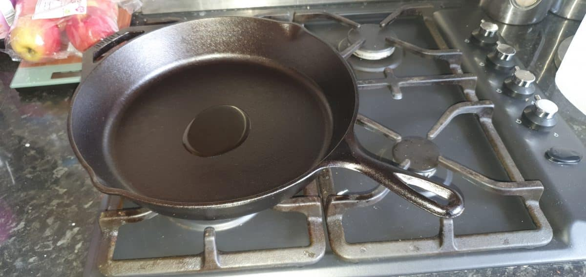 A small amount of oil in a cast iron pan