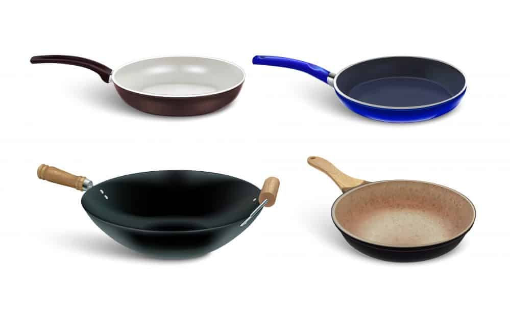an image of a wok and three different frying pans